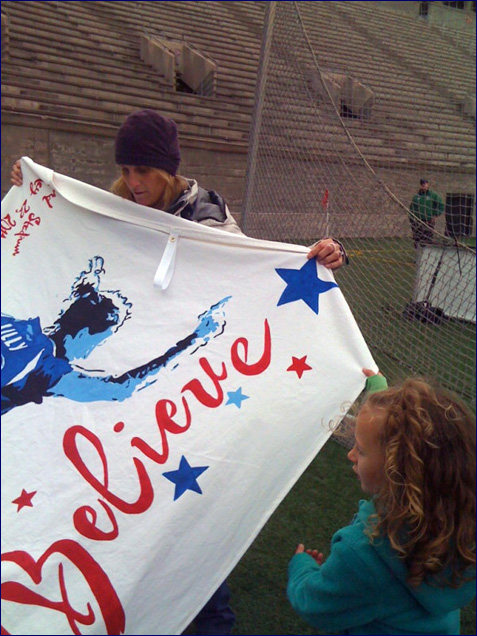 lilly holds her banner